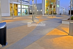 The racetrack infield at the nearby Daytona International Speedway inspired this unique decorative concrete paving with an interior checkerboard pattern that was created using Bomanite Integral Color with two-tone coloration and will provide longevity and durability of color.