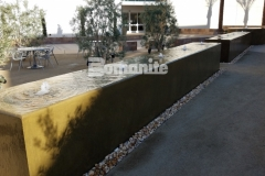 Using Bomanite integrally colored concrete and a smooth trowel finish, Heritage Bomanite formed the walls of this fountain and created a beautiful, therapeutic, and soothing water feature outside of the Clovis Community Medical Center.