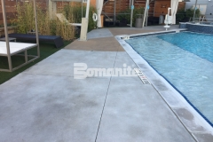 Earning the 2017 Bronze Award for Best Bomanite Exposed Aggregate Project, our associate Bomanite of Tulsa, Inc., installed Bomanite Exposed Aggregate Alloy in Nickel Gray and Gobi Desert to create a hardscape surface with a glamorous decorative touch that enhances the design aesthetic throughout the Hard Rock Hotel pool area.