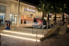 Bomanite Alloy was installed here with exposed seashells to create this decorative concrete step plaza and handicap ramp and the beautifully distinct finish accentuates the beach-industrial aesthetic styling at the Tanger Outlets in Daytona Beach, FL.