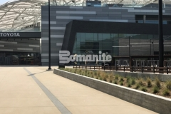 The Bomanite Alloy Exposed Aggregate System was utilized here with clear glass aggregates and reflective mirror flakes to create decorative concrete bands that serve as line formations that direct fans into the LAFC Stadium and add sparkle and sophisticated detail to the hardscape.