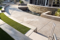 This impressive courtyard area was created using Bomanite Sandscape Refined Antico decorative concrete in Bomanite Light Brown with a pattern that radiates outward from the baptismal pool to form seating areas, viewing sections, and various gathering spaces at CrossCity Christian Church.