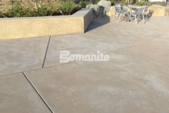 Sandscape Refined Antico by Bomanite was chosen to create a decorative concrete hardscape surface with variation in texture and cohesive design features that connect the gathering spaces throughout this multi-use plaza area.