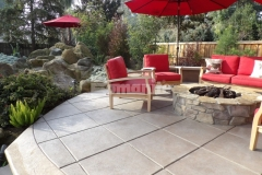 Decorative design detail was added to this concrete hardscape using the Bomanite Exposed Aggregate Antico process and the cost-effective finish adds beautiful character and warmth to this backyard retreat.