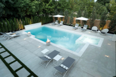 The homeowner's desire for a modern space that can be enjoyed in any season was fulfilled by creating this decorative concrete patio and pool deck and the utilization of Bomanite Sandscape Refined provided a fine aggregate finish that adds the perfect industrial touch to the exterior of their home.