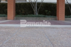 Featured here is Bomanite Bomacron English Sidewalk Slate imprinted concrete that was installed with a Bomanite Sandscape Texture finish to renew the entrance to the Residence Condominiums and this stylish and functional hardscape surface will not show wear from traffic or need constant resealing to look fresh.