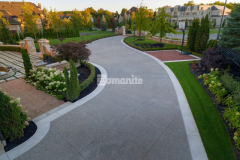 Approximately 3,000 square feet of Bomanite Sandscape Texture decorative concrete was installed here – the main driveway features Buckskin Integral Color and the banding along the driveway was formed and poured separately using a Limestone textured finish – and the distinct design is a perfect complement to the exterior of the home.