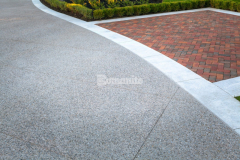 The Silver Award for Best Bomanite Exposed Aggregate Project was awarded to our colleague Bomanite Toronto for their stunning design and installation of this beautiful Bomanite Sandscape Texture decorative concrete driveway that was the perfect addition to enhance the aesthetic of this home and provide a durable paving surface.