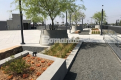 Bomanite Exposed Aggregate Sandscape Texture was added to create textural detail on these lineal planters and circular tree planters and this beautiful finish is a perfect complement to the geometrical arrangement of the pedestal pavers on this rooftop terrace and garden.