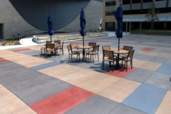 Bomanite Sandscape Texture was installed here with a detailed stain pattern to create a decorative concrete hardscape with visual interest that complements the surrounding architecture while maintaining visual continuity throughout the space.