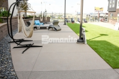 Bomanite Sandscape Texture decorative concrete was installed throughout the COLAB Co-Housing community to create hardscape walking paths and courtyards and provided a finish that resembles sand blasted concrete and enhances the modern aesthetic.