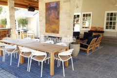 Bomanite Sand Color Hardener and French Gray Release Agent were combined here with the Bomanite Bomacron English Sidewalk Slate pattern to create a multi-functional decorative concrete hardscape that provides long-term durability for dining, entertaining, and play.