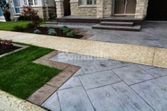 Bomanite Yorkshire Stone imprinted concrete was installed here to create a new driveway and patio and the use of Bomanite Shale Gray Color Hardener and a Gray Release Agent provide distinctive design detail that enhances the home's architecture.