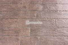 This durable hardscape surface features Bomanite Bomacron imprinted concrete that was stamped with the Random Boardwalk pattern, creating a wood plank look that enhances the exterior spaces throughout the Tanger Outlets Fort Worth.