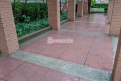 The existing brick exterior colors at the Residence Condominiums are beautifully complemented by the new Bomanite Bomacron Slate Texture imprinted sidewalk that features Bomanite Cafe Au Lait Integral Color for the sidewalk bands and Bomanite Franciscan Red Color Hardener for the main expanse of the walkway.