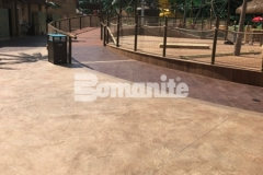 Bomanite Bomacron Regular Slate stamped concrete was installed here to create a durable decking surface around this water feature at Canobie Lake Park, adding a beautiful textural element and distinctive detail to the hardscape.