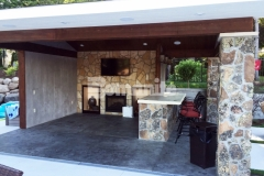 Bomanite Imprint Systems were utilized here to create this decorative concrete flooring, using an integral gray color for the base that was stamped with the Bomacron Slate Texture pattern, and was then antiqued and color washed in a darker gray to create this picture-perfect backyard cabana.