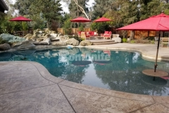 The Bomacron Slate Texture pattern was combined here with Bomanite Sand Color Hardener and Bomanite Light Brown Release Agent to create a stamped concrete pool deck and patio area with beautiful textural detail that is perfect in this entertaining space.