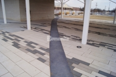 The Bomanite Sandstone pattern was chosen to create textured, imprinted concrete throughout the accent borders in this pavilion area, adding beautiful detail to the hardscape while providing delineation around the concrete pavers at Redbud Festival Park in Owasso, Oklahoma.