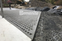 This charming hardscape surface features Bomanite Grasscrete pervious concrete and this product was the perfect choice for this space to create access for large delivery vehicles while providing a permanent solution for stormwater management.