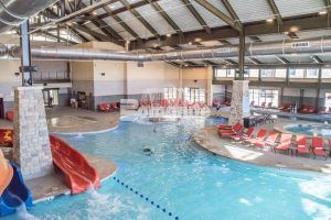 An all-year indoor pool with Bomanite Imprint and Bomanite Sandscape Texture decorative concrete at Gaylord Rockies Resort and Convention Center in Aurora, CO installed by Colorado Hardscapes.