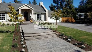 Front of the house of a private residence in Fresno, CA with decorative concrete installed by Heritage Bomanite using Bomanite Impprint Systems with English Sidewalk Slate Pattern.