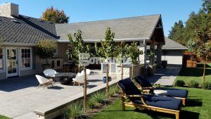 Long view of firepit and patio seating areas in Fresno, CA, where Heritage Bomanite installed decorative concrete using Bomanite Imprint Systems with English Sidewalk Slate Pattern.