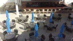 Umbrella tables provide a pleasant upscale eating area at Westchester CC Beach Club featuring Bomanite Revealed Exposed Aggregate Systems decorative concrete installed by Beyond Concrete of Keyport, NJ.