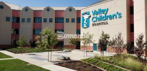 Courtyard at entrance to Valley Children's Hospital featuring Bomanite Decorative Exposed Aggregate Revealed and Sandscape Texture Systems installed by Heritage Bomanite located in Fresno, CA.