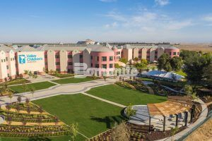 Aerial wide angle view of front grounds and fundraising events area of Valley Children's Hospital with Bomanite Decorative Exposed Aggregate Revealed and Sandscape Texture Systems installed by Heritage Bomanite located in Fresno, CA.
