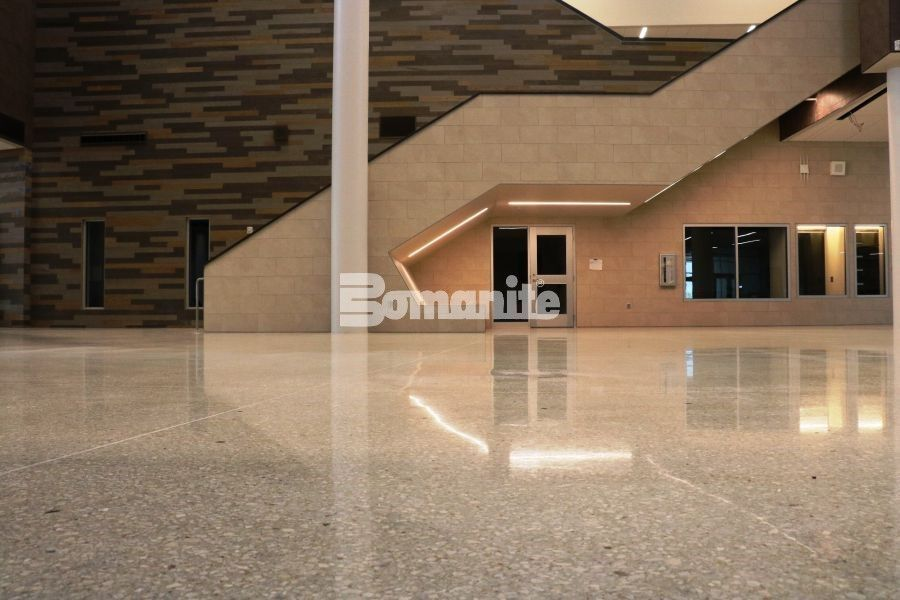 The Bomanite Renaissance Polished Concrete system provided design flexibility, first-cost savings and lower cost maintenance for the new construction of the Olathe West High School interior floors located in Olathe, KS, and installed by Musselman & Hall Contractors.