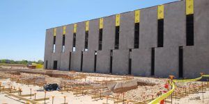 Sundt Construction before picture of Bomanite Patène Artectura vertically stained decorative concrete wall panels at The Beast Urban Park multi-generational Rec Center in El Paso, TX, colored by Bomanite Artistic Concrete.