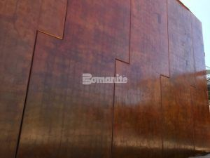 Close up of Bomanite Patène Artectura vertically stained decorative concrete wall panels at The Beast Urban Park multi-generational Rec Center in El Paso, TX, colored by Bomanite Artistic Concrete and installed by Sundt Construction.